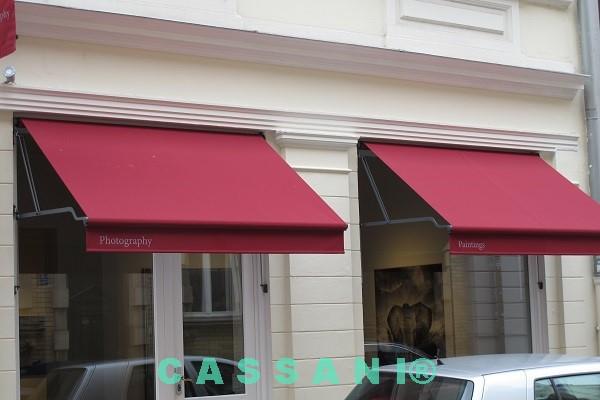 Fassadenmarkisen Sonderkonstruktion mit Führungsstab für Geschäfte und Schaufenster